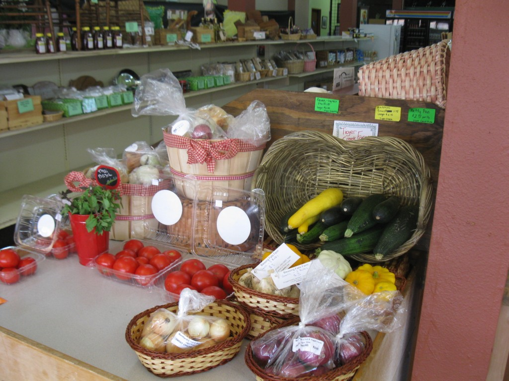 Produce from several farms greet you as you enter the store.  Our garlic is on this table.