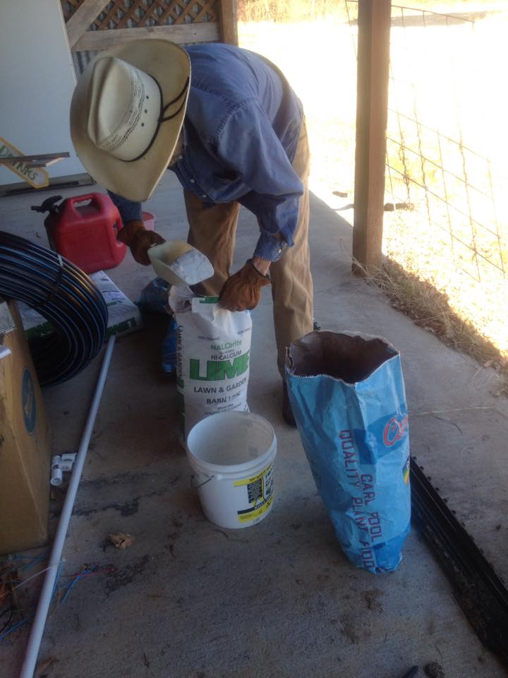 Mixing lime and soft rock phosphate.  These natural rock powders provide the essential minerals calcium and phosphorus.