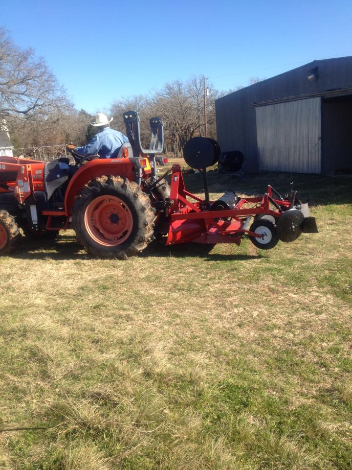 Tiller is removed and plastic mulch layer is attached to the tractor